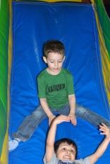 Sasha going down the bouncy castle slide
